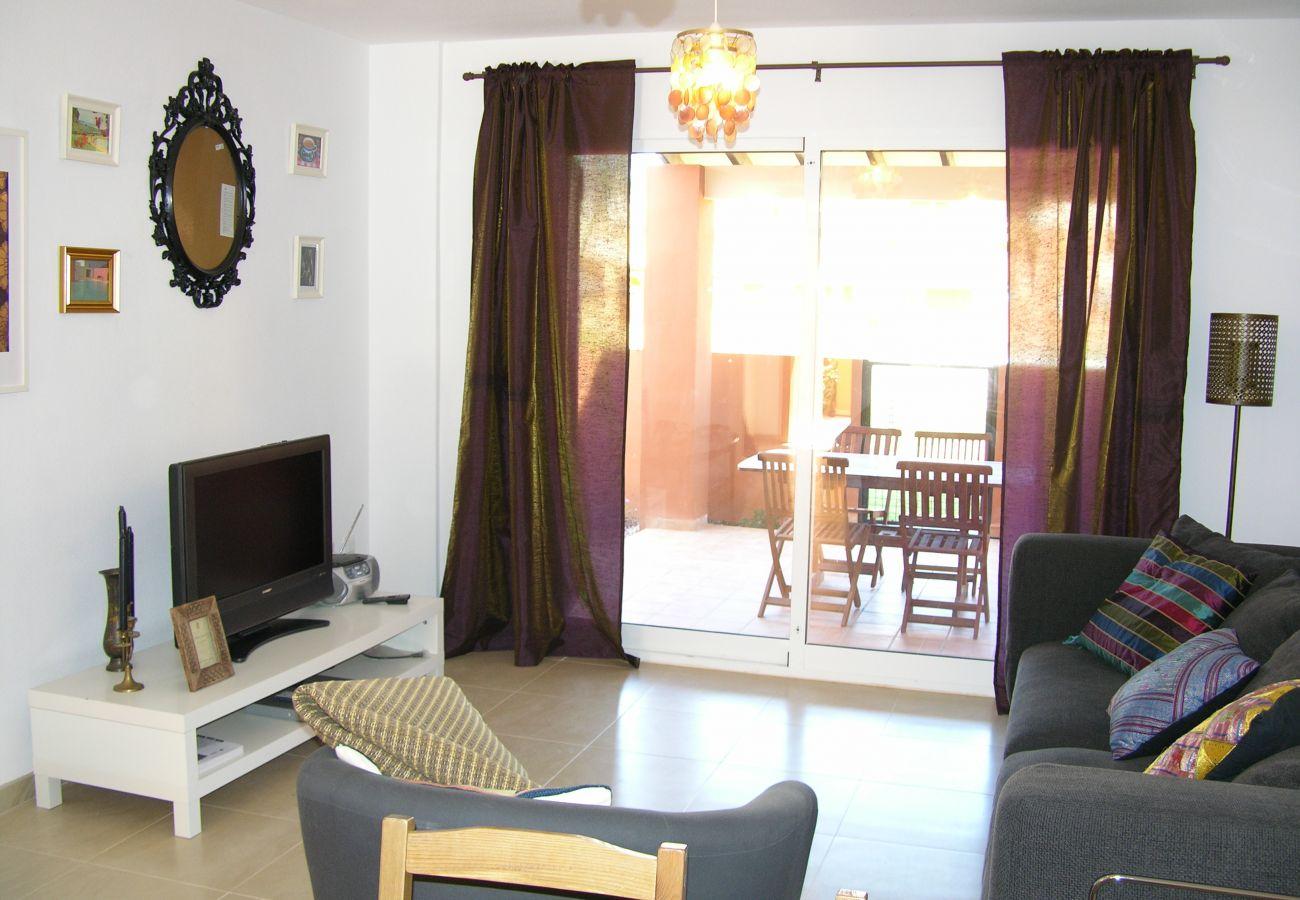 Salón bien equipado y decorado - Resort Choice
