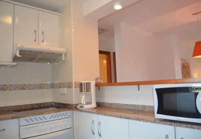 Gran cocina con electrodomésticos modernos - Resort Choice