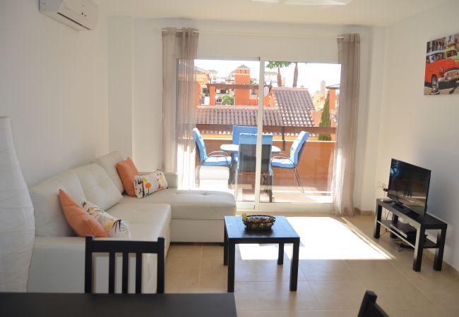 Salón con aire acondicionado, tv moderna - Resort Choice