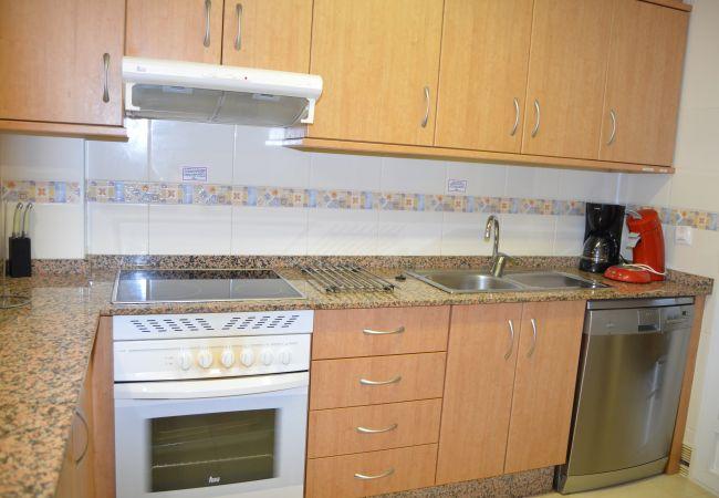 Cocina moderna con electrodomésticos modernos - Resort Choice