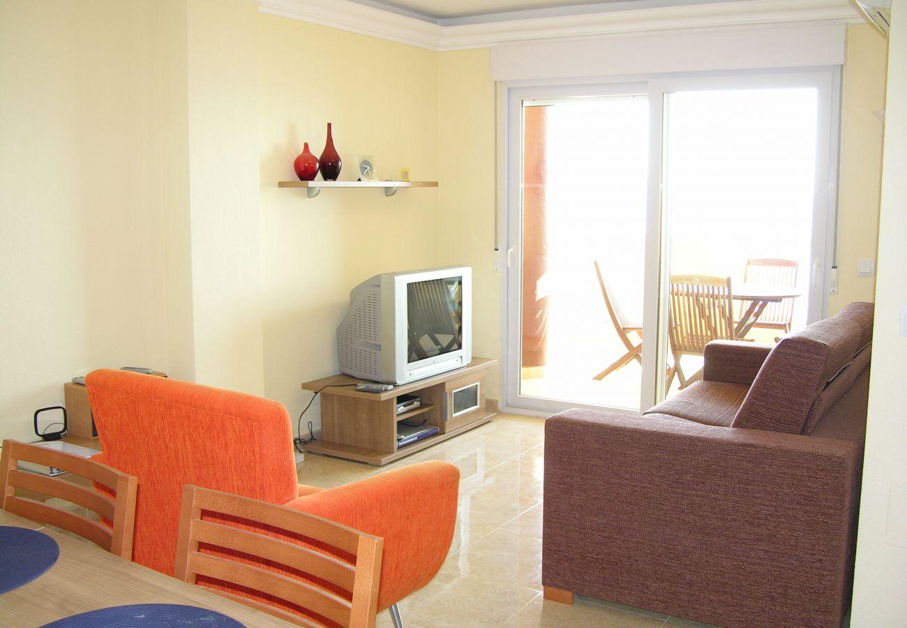Salón bien equipado con mobiliario moderno - Resort Choice