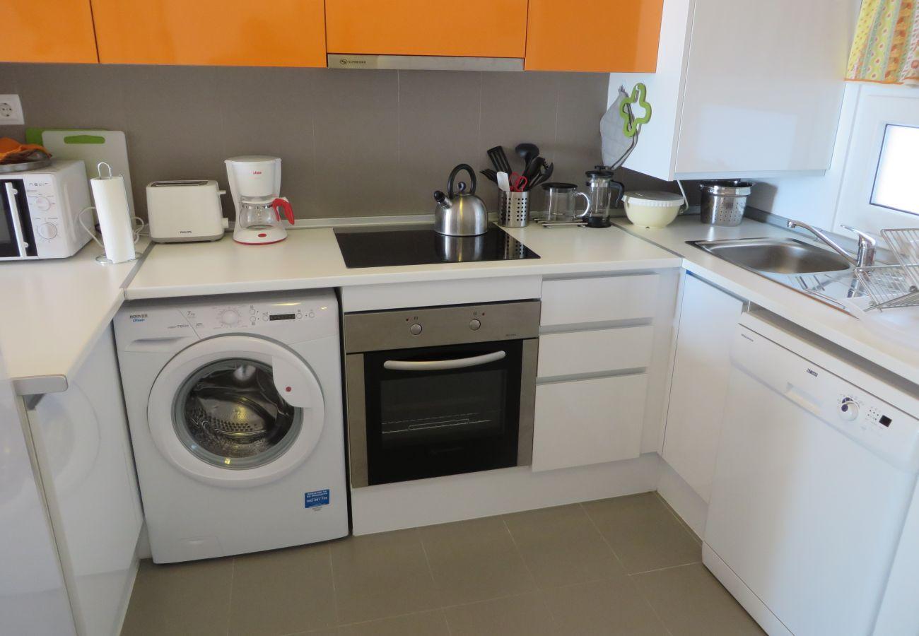Apartamento con cocina con electrodomésticos modernos - Resort Choice